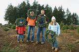 Family with christmas wreaths