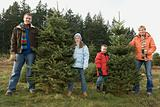 Family with christmas trees