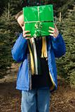 Boy holding christmas gift up