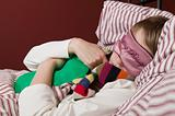 Girl sleeping with a hot water bottle