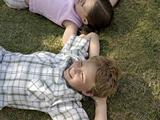 Children lying on grass