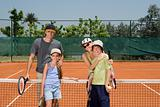 Family on a tennis court