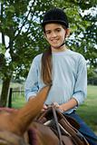 Girl sitting on horse