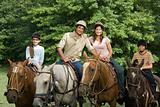 Family riding horses