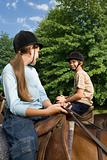 Children riding horses