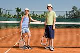Brother and sister a tennis court