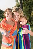 Mother and kids in towels