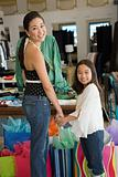 Mother and daughter in clothes shop