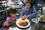 Girl and grandmother having a meal
