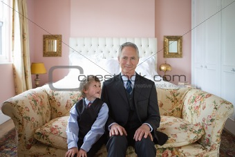 Boy and grandfather in business suits
