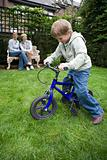 Boy riding a bicycle in garden