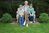 Grandmother and grandchildren in garden