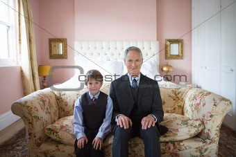 Boy and grandfather in suits