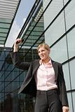 Businesswoman waving outdoors