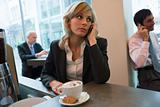 Woman on phone in coffee bar