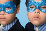 Twin boys wearing eye masks