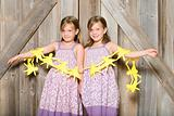 Twin girls holding a paper chain