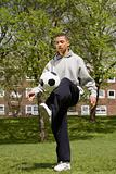 Teenage boy playing keepy uppy