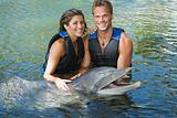 Couple with dolphin