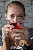 Young woman with cosmopolitan cocktail