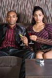 Young couple with cocktails