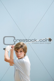 Boy mid golf swing