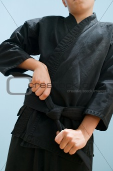 Boy preparing for martial arts