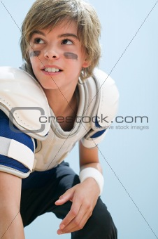 Boy in american football uniform