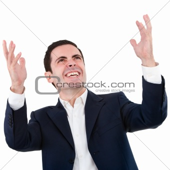 Portrait of happy business man raising hands