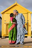 Indian couple kissing outside beach hut