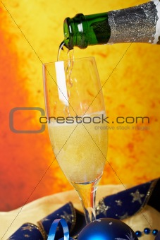 Pouring champagne on glass