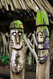 Two wooden totems (idols) near african village