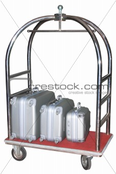 Three similiar suitcases on hotel baggage cart isolated