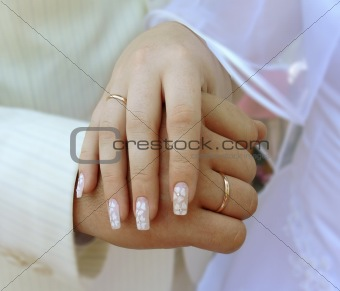 Brinde and groom hands with rings