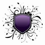 Purple and black shield emblem with floral design