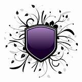Purple and black shield emblem with floral design