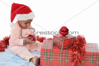 baby girl with christmas presents
