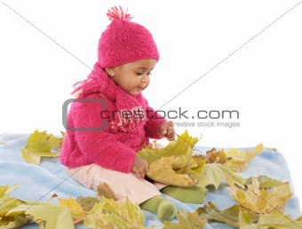 Baby playing with leaves