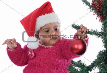 baby girl playing with christmas tree