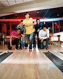 Group of young men bowling