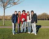 Men with a football in park