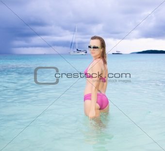 Beautiful model posing on the ocean
