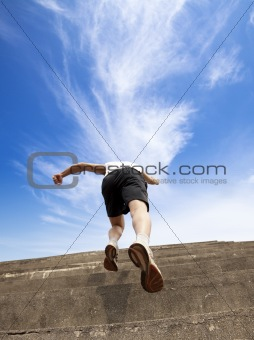 Man running up stairs