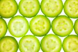 Slices of zucchini or courgette isolated on white / back lit