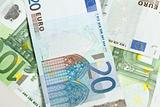 Euro banknotes arranged in background