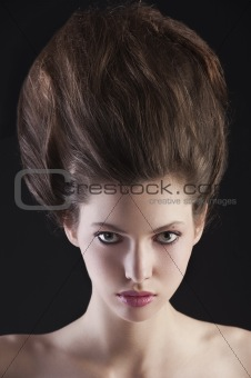 brunette with creative up hairdo