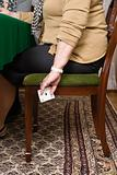 Senior woman hiding playing cards