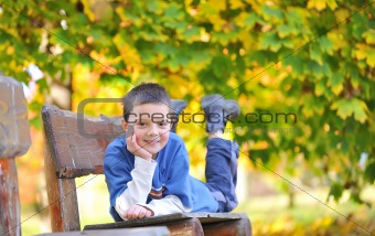 boy laying down on a bench