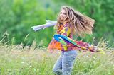 Jumping girl against summer meadow