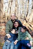 Happy Family Portrait in the Woods